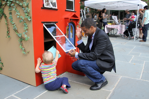 "Leon Reid IV lends a helping hand at his opening for ""The Hundred Story House"" (photo by Becki Fuller, © Leon Reid IV)"